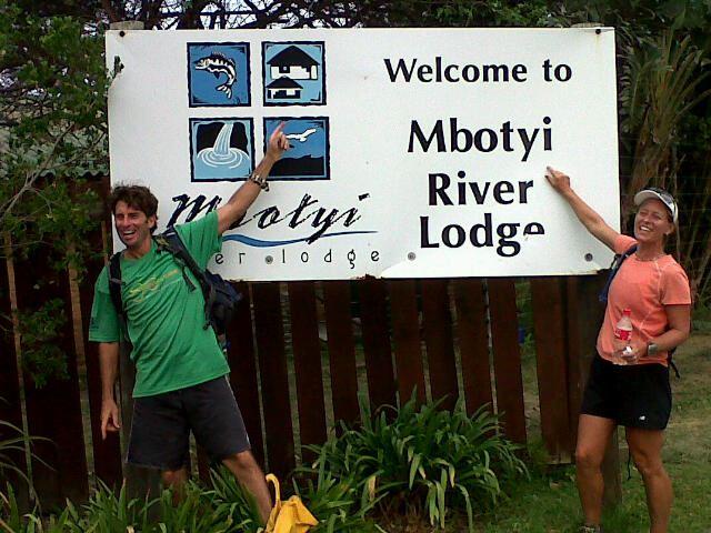 Kim van Kets standing at the Mbotyi River Lodge Sign