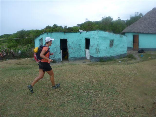 Kim van Kets running through a rural village in teh Transkei