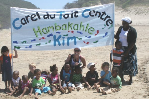 Kim van kets and the children from the Carel du Toit Centre for deaf children